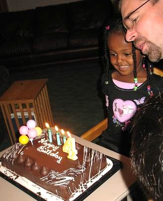 Blowing out candles with Daddy