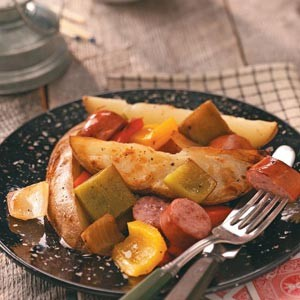 Potatoes and sausage in foil
