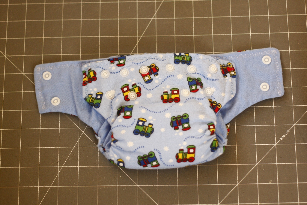 Snaps on a size small diaper